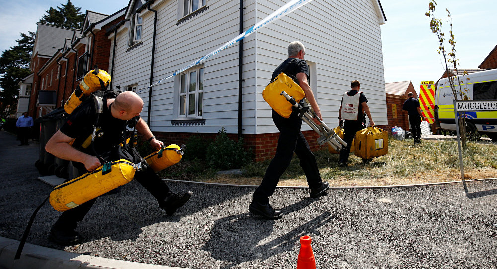 Fire and Rescue Service personel arrive with safety equipment at the site of a housing estate on Muggleton Road, after it was confirmed that two people had been poisoned with the nerve-agent Novichok, in Amesbury, Britain, July 6, 2018
