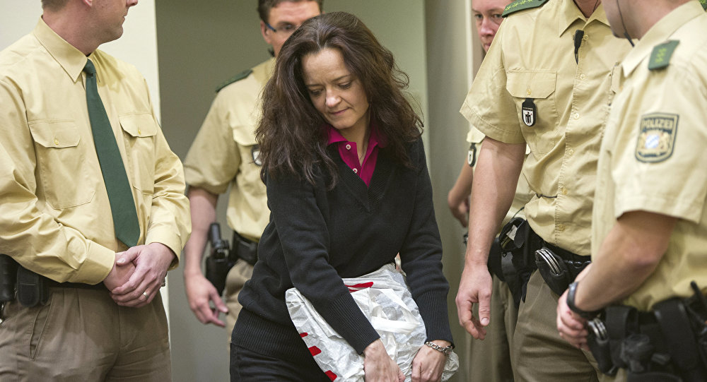 Beate Zschaepe, alleged member of the neo-Nazi group National Socialist Underground (NSU) enters a court room in Munich, southern Germany, Tuesday, June 4, 2013