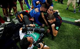 Soccer Football - World Cup - Semi Final - Croatia v England - Luzhniki Stadium, Moscow, Russia - July 11, 2018 Croatia players celebrate next to an AFP photographer Yuri Cortez after Mario Mandzukic scores their second goal
