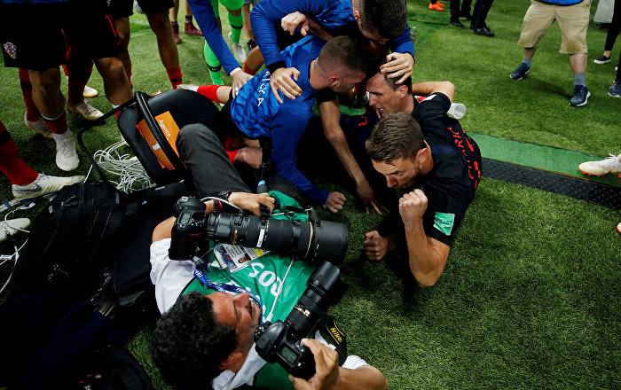 Soccer Football - World Cup - Semi Final - Croatia v England - Luzhniki Stadium, Moscow, Russia - July 11, 2018 Croatia players celebrate next to an AFP photographer Yuri Cortez after Mario Mandzukic scores their second goal