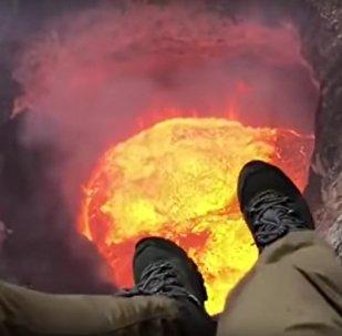 Helicopter Pilot Records Himself Dangling From Zipline Over Vanuatu Volcano