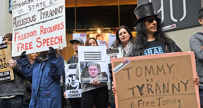 Members of the Australian Liberty Alliance (ALA) and supporters protest outside the British consulate in support of jailed British right-wing activist and former leader to the English Defence League (EDL) Tommy Robinson, aka Stephen Christopher Yaxley-Lennon, in Melbourne on June 9, 2018