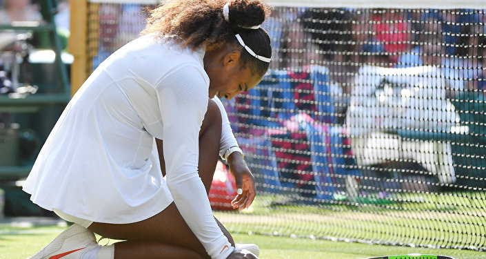 Tennis - Wimbledon - All England Lawn Tennis and Croquet Club, London, Britain - July 14, 2018. Serena Williams of the U.S. reacts during the women's singles final against Germany's Angelique Kerber
