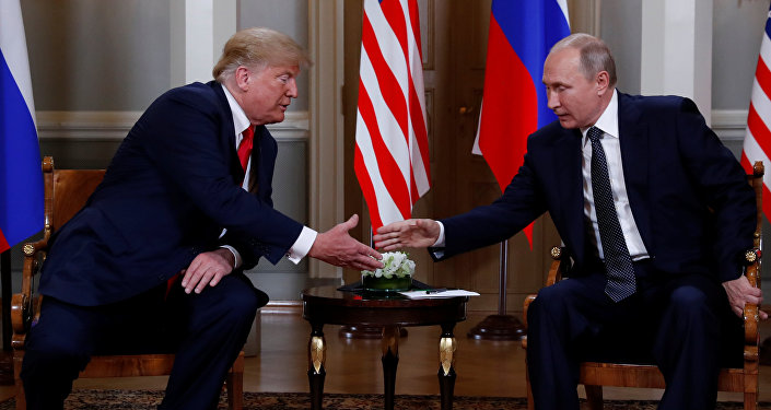 U.S. President Donald Trump and Russia's President Vladimir Putin shake hands as they meet in Helsinki, Finland July 16, 2018