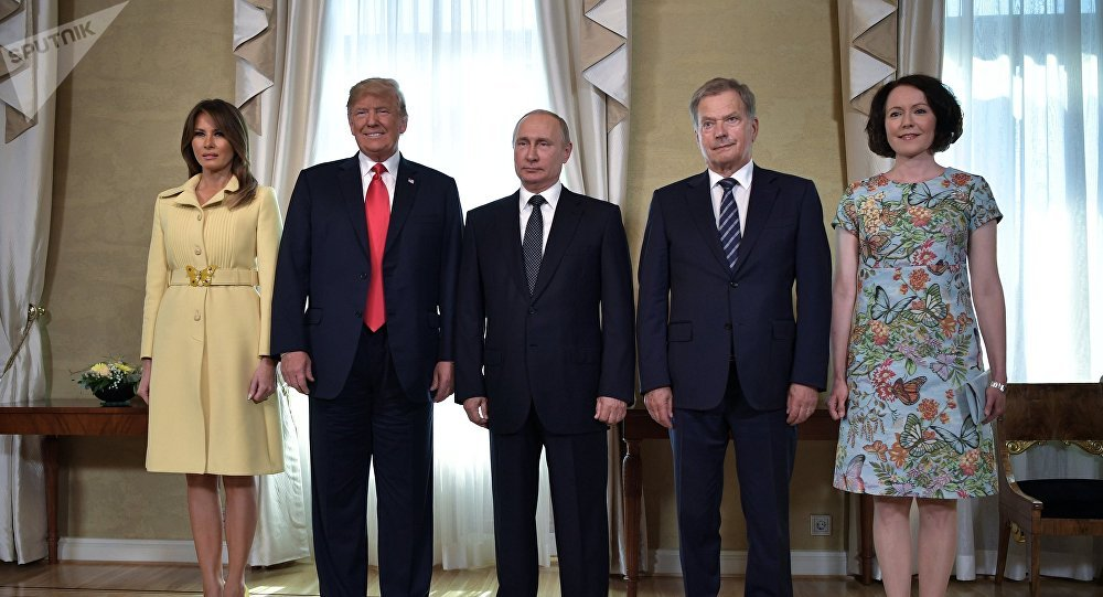 Russia's President Vladimir Putin (C), US President Donald Trump (2nd L), First lady Melania Trump (L), Finland's President Sauli Niinisto (2nd R) and his wife Jenni Haukio pose for a picture during a meeting in Helsinki, Finland July 16, 2018.