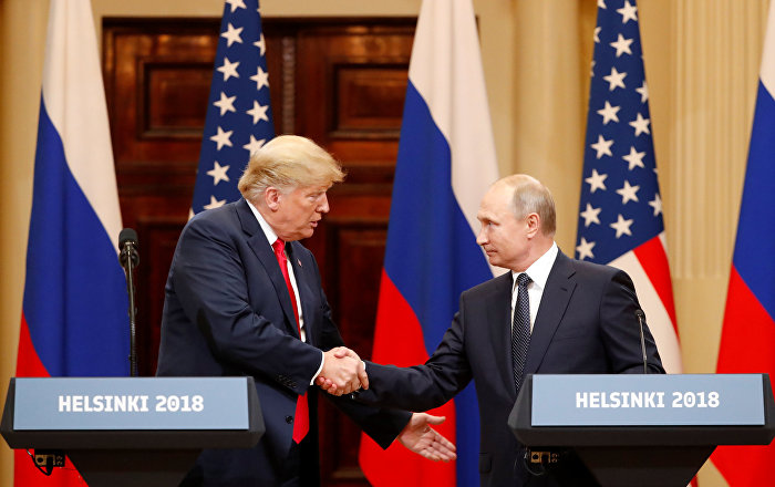 US President Donald Trump and Russian President Vladimir Putin shake hands as they hold a joint news conference after their meeting in Helsinki, Finland July 16, 2018