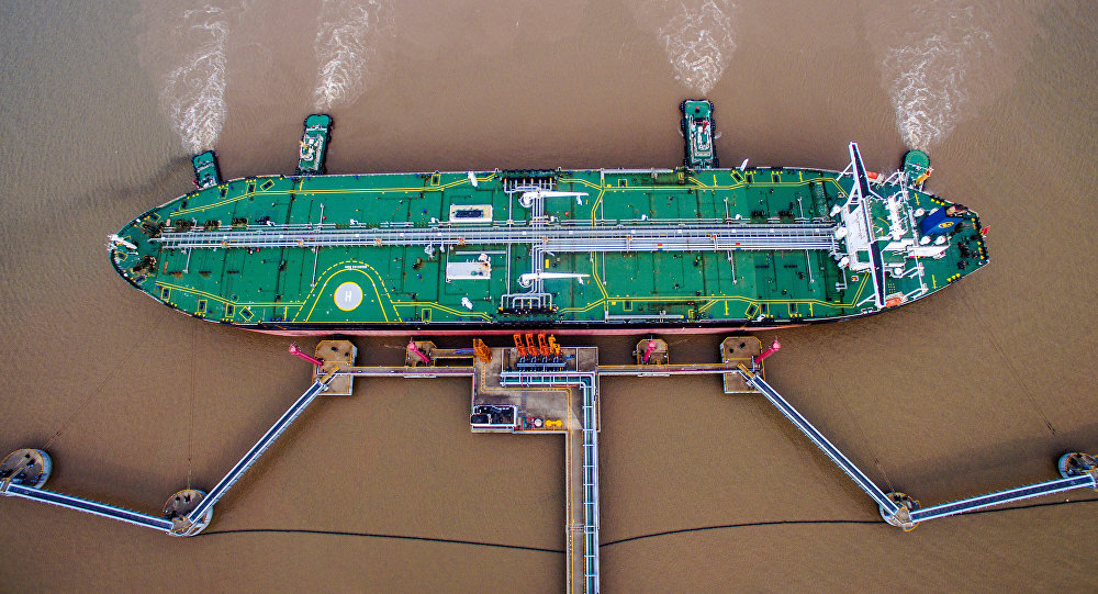 An oil tanker unloads crude oil at a crude oil terminal in Zhoushan, Zhejiang province, China July 4, 2018