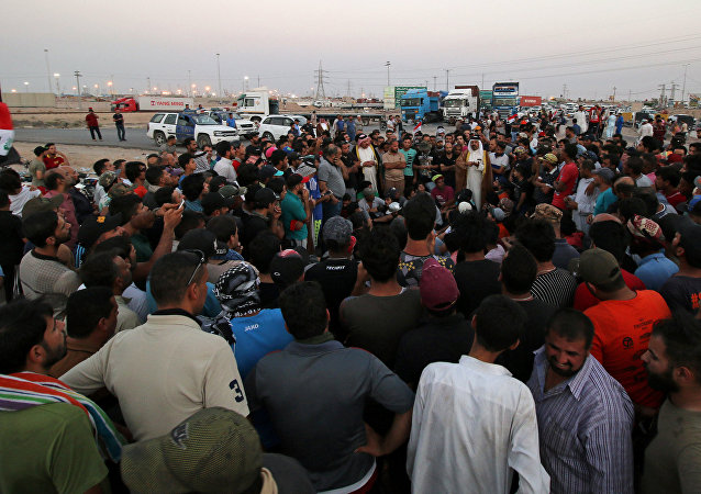 Protesters block the road to Iraq's Umm Qasr port, south of Basra, Iraq July 13, 2018.