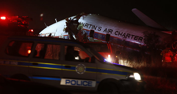 A charter plane lays in a field in Pretoria South Africa Tuesday