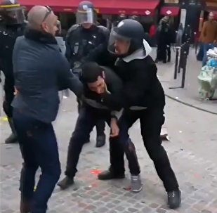 In this image taken from video, a man identified as Alexandre Benalla, right, a security chief to French President Emmanuel Macron, confronting a student during a May Day demonstration in Paris, May 1, 2018