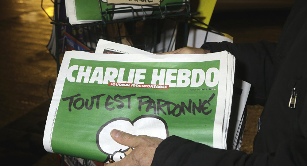In this Wednesday, Jan. 14, 2015, file photo, a seller of newspapers stocks several Charlie Hebdo newspapers at a newsstand in Nice, France. The French satirical newspaper Charlie Hebdo will publish a German version in the country that has given the best reception to the weekly paper outside France since the attacks that wiped out the Paris editorial staff in January 2015
