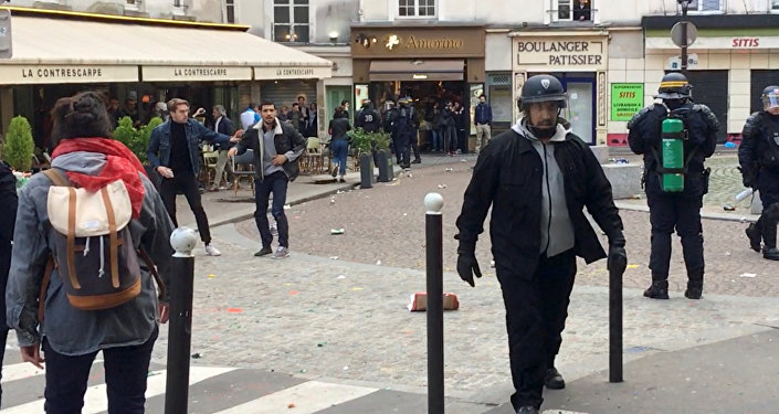 Macron's bodyguard walks after clashing with a May Day protester in Paris, France, May 1, 2018