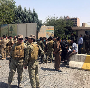 Kurdish security forces gather near an Erbil governorate building in Erbil, Iraq July 23, 2018