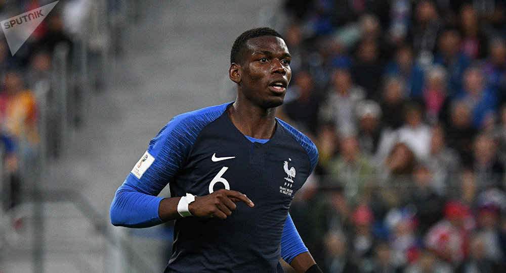 France's Paul Pogba runs during the World Cup semifinal soccer match between France and Belgium at the Saint Petersburg Stadium, in St.Petersburg, Russia, July 10, 2018