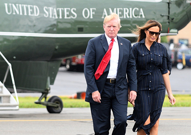 U.S. President Donald Trump and First Lady Melania Trump disembark Marine One upon departure from Morristown in New Jersey, U.S., July 22, 2018