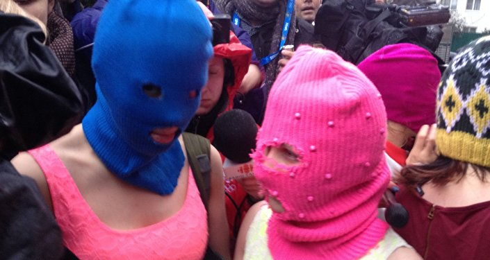 Pussy Riot members speaking to press after their release from police (File)