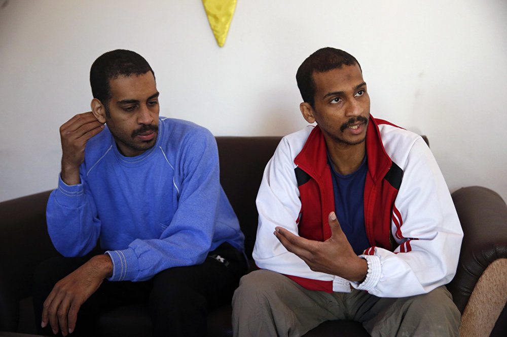 Alexanda Amon Kotey, left, and El Shafee Elsheikh, who were allegedly among four British jihadis who made up a brutal Islamic State cell dubbed The Beatles, speak during an interview with The Associated Press at a security center in Kobani, Syria, Friday, March 30, 2018.