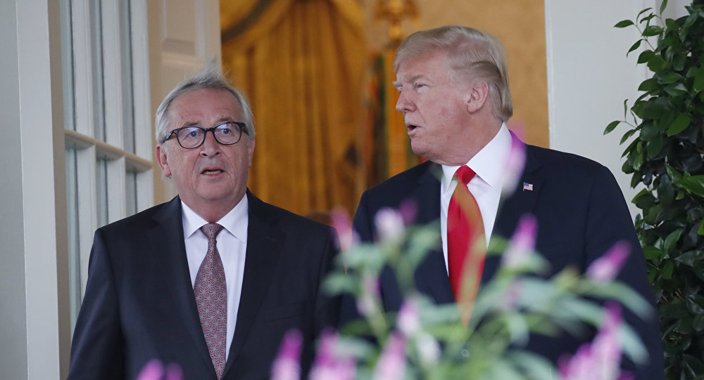 US President Donald Trump, right, and European Commission president Jean-Claude Juncker arrive to speak in the Rose Garden of the White House on 25 July 2018 in Washington