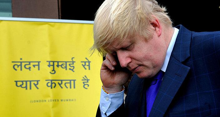 (File) Boris Johnson takes a phone call during an interaction with Indian media representatives in Mumbai on November 29, 2012