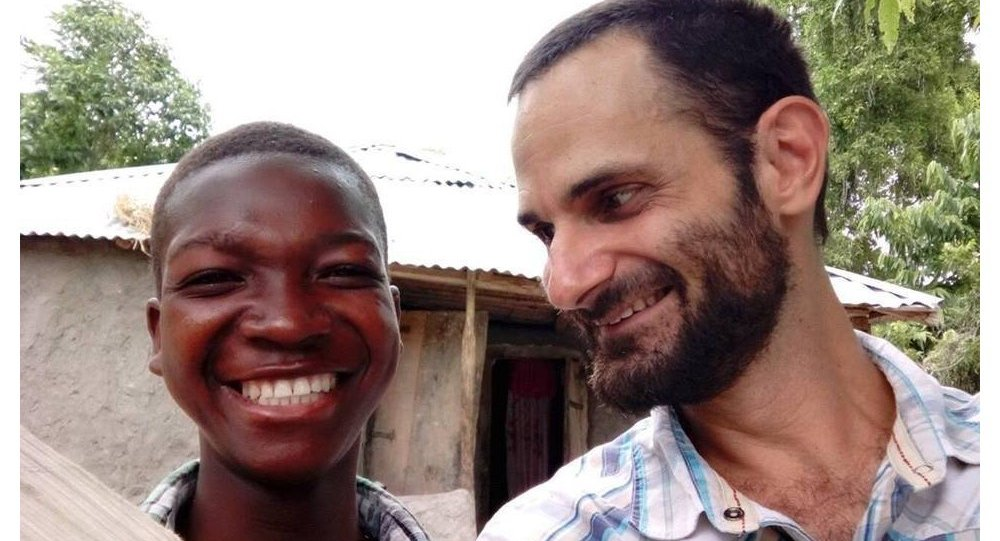 James Arbaugh (R) is seen with a Haitian boy