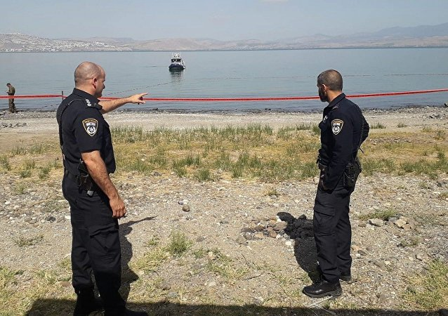 Police searching for a pair of missiles fired from Syria which eyewitnesses said landed in the Sea of Galilee, July 26, 2018