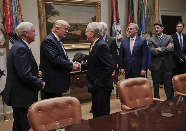 President Donald Trump shakes hands with Senate Majority Leader Mitch McConnell of Ky., center, before the start of a meeting with House and Senate Leadership in the Roosevelt Room of the White House in Washington, Tuesday, June 6, 2017