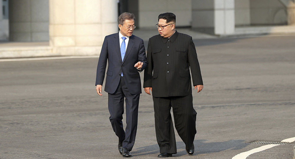 North Korean leader Kim Jong-un, right, talks with South Korean President Moon Jae-in at the border village of Panmunjom in the Demilitarized Zone, South Korea, Friday, April 27, 2018