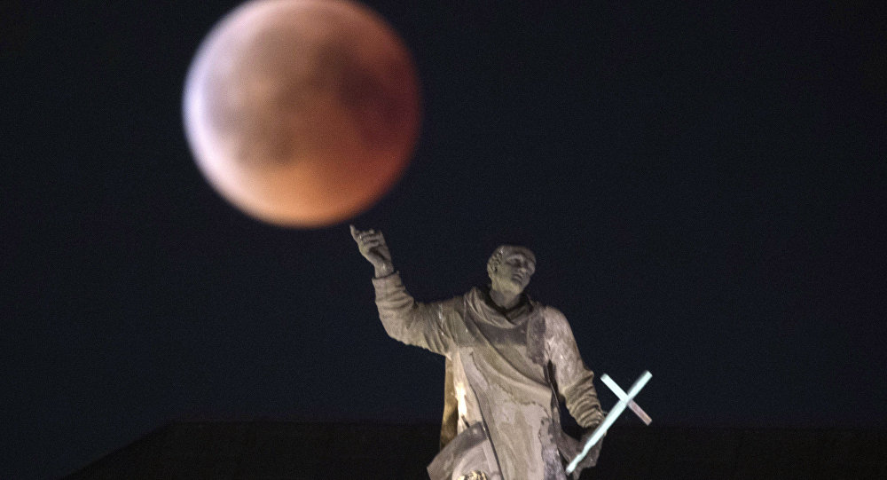 The moon turns red during a total lunar eclipse, as seen from Dresden, Germany, 27 July 2018.