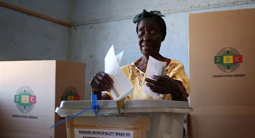 A woman casts her ballot in the country's general elections in Harare, Zimbabwe, July 30, 2018