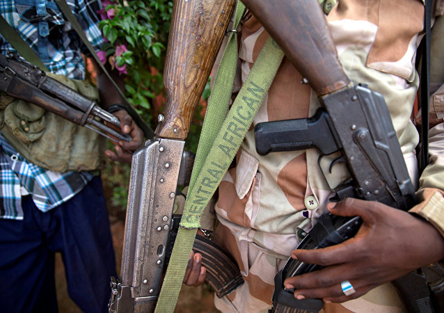 An armed fighter belonging to the 3R armed militia displays his weapon in the town of Koui, Central African Republic, April 27, 2017