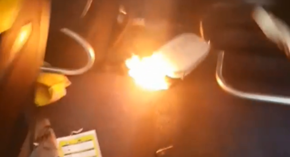 Ryanair flight gets evacuated after portable charger bursts into flames moments before takeoff