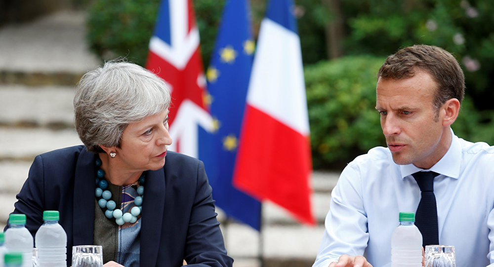 French President Emmanuel Macron meets with British Prime Minister Theresa May at the Fort de Bregancon in Bormes-les-Mimosas, France, August 3, 2018.