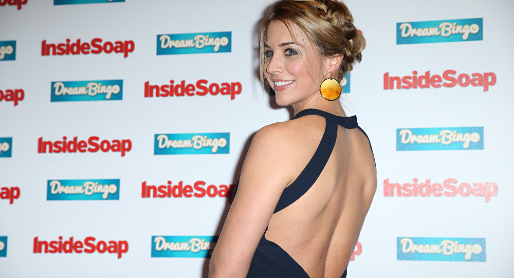 Gemma Atkinson poses for photographers upon arrival at the Inside Soap Awards, Monday, Oct. 5, 2015.