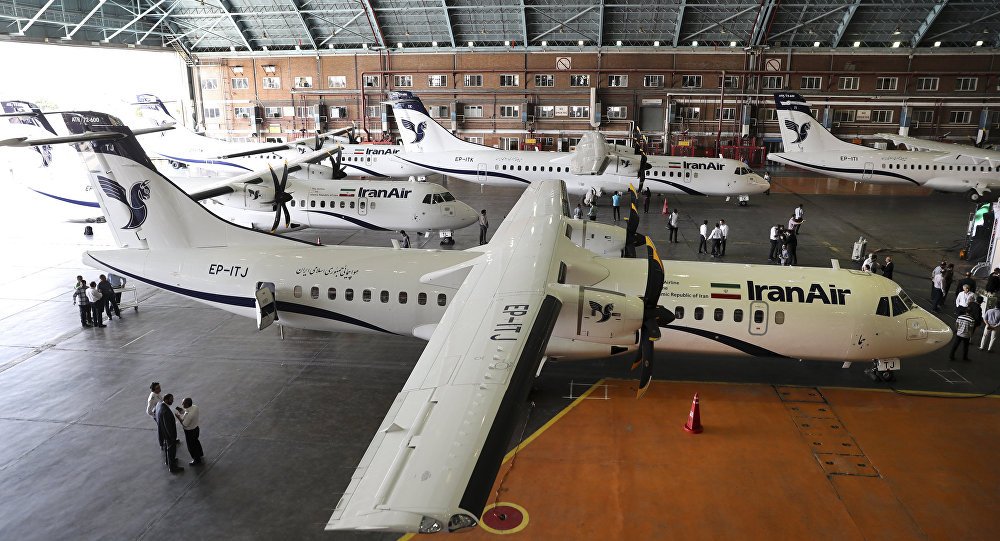 In this photo provided by Tasnim News Agency, Iran Air's new commercial aircrafts are parked at Mehrabad airport in Tehran, Iran, Aug. 5, 2018