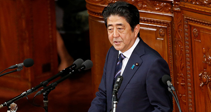 Japanese Prime Minister Shinzo Abe gives an address at the start of the new parliament session at the lower house of parliament in Tokyo, Japan