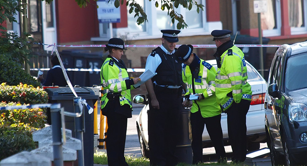 Police officers at the scene of the assassination of Pakistani exiled politician Imran Farooq in London in 2010