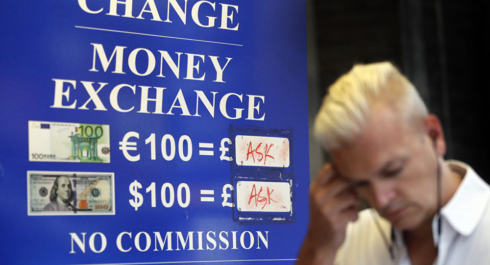 A man passes a currency exchange board in London