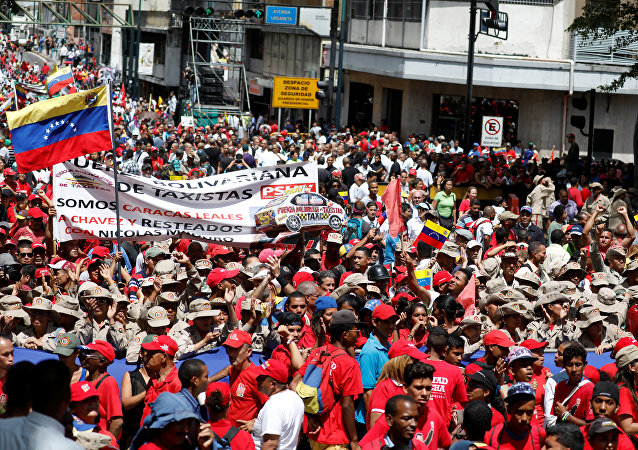 Militia members and supporters of Venezuela's President Nicolas Maduro attend a rally in support of him in Caracas, Venezuela August 6, 2018.