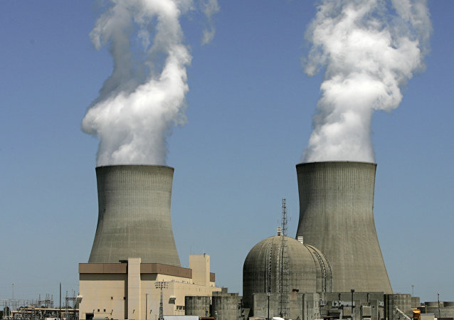 In this photo taken April 28, 2010, steam rises from the cooling towers of nuclear reactors at Plant Vogtle, in Waynesboro, Ga.