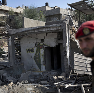 A Palestinian Hamas military policeman inspects the damage caused by Israeli airstrikes in Gaza City, Thursday, Aug. 9, 2018. Israel struck targets in the Gaza Strip after dozens of rockets were launched Wednesday from the coastal territory ruled by the Islamic militant Hamas group, the Israeli military said