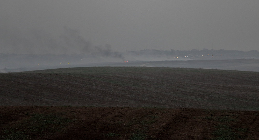 A distant shot of fires burning outside Gaza.