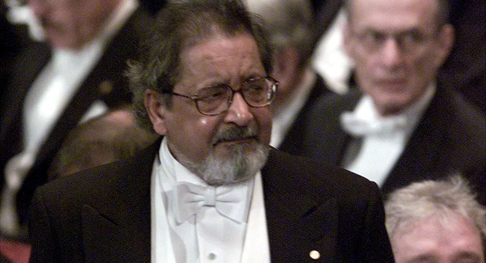 FILE PHOTO: Writer V.S. Naipaul waits to receive his Nobel prize for literature at Stockholm's Konserthuset from Sweden's King Carl Gustaf, Sweden December 10, 2001.