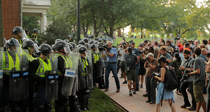 Virginia State Police officers form a cordon at the University of Virginia, ahead of the one year anniversary of the 2017 Charlottesville Unite the Right protests, in Charlottesville, Virginia, U.S., August 11, 2018.