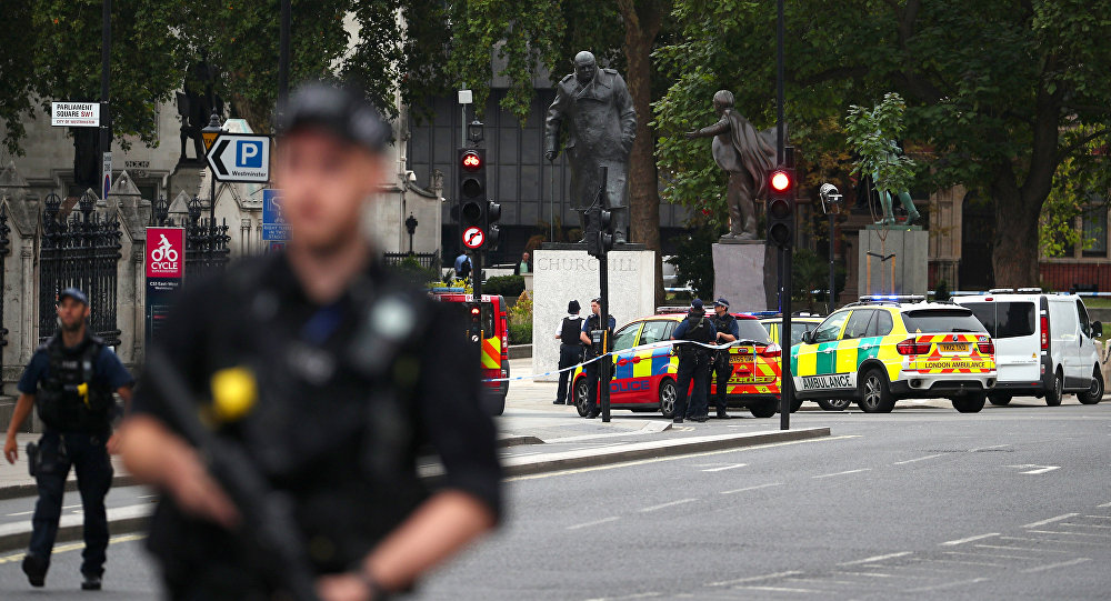 Armed police stand in the street after a car crashed outside the Houses of Parliament in Westminster, London, Britain, August 14, 2018
