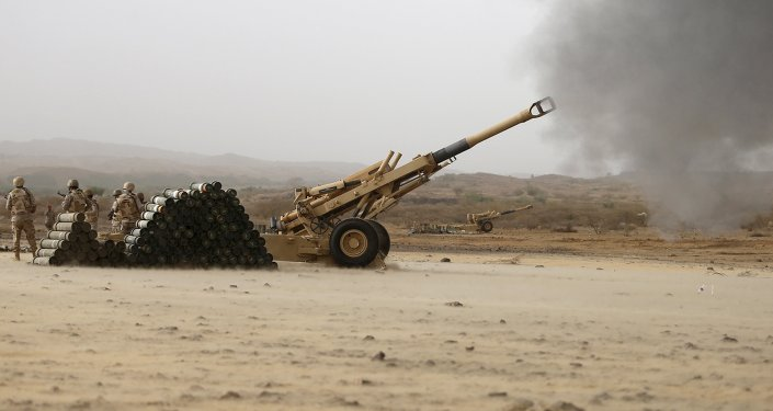 Saudi army artillery fire shells towards Houthi positions from the Saudi border with Yemen April 13, 2015