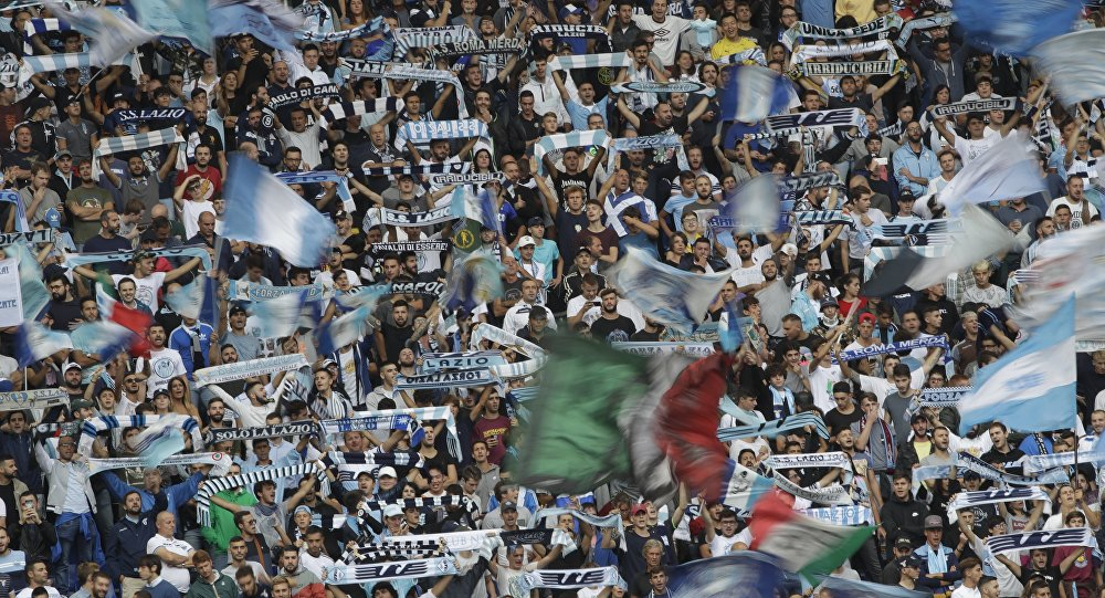 Lazio fans cheer prior to a Serie A soccer match between Lazio and AC Milan, at the Rome Olympic stadium, Sunday, Sept. 10, 2017