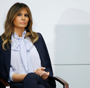 """U.S. first lady Melania Trump waits to speak at the Federal Partners in Bullying Prevention (FPBP) Cyberbullying Prevention Summit on """"the positive and negative effects of social media on youth"""" in Rockville, Maryland, U.S., August 20, 2018."""
