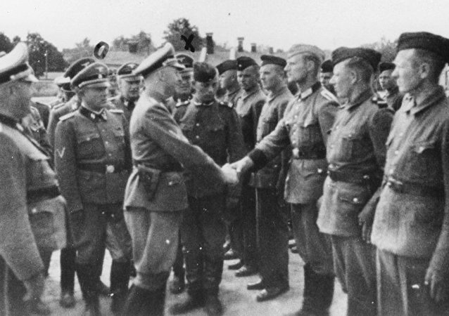 This 1942 photo provided by the the public prosecutor's office in Hamburg via the United States Holocaust Memorial Museum, shows Heinrich Himmler, center left, shaking hands with new guard recruits at the Trawniki concentration camp in Nazi occupied Poland.