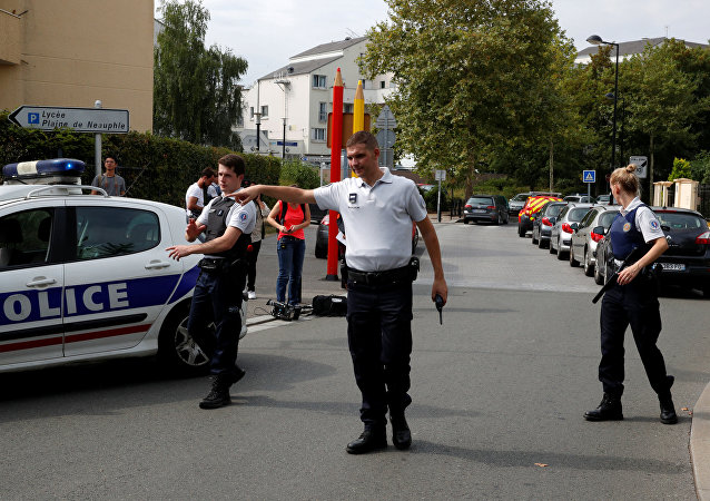 French police secure a street after a man killed two persons and injured an other in a knife attack in Trappes, near Paris, according to French authorities, France, August 23, 2018