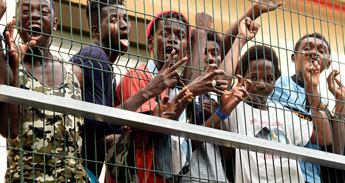 Migrants of the immigrant center CETI welcomes newly arrived African immigrants in the Spanish enclave Ceuta, after some 200 refugees crossed the border fence between Morocco and Ceuta August 22, 2018